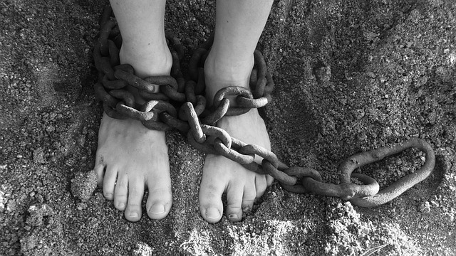 photo of feet wrapped with chains